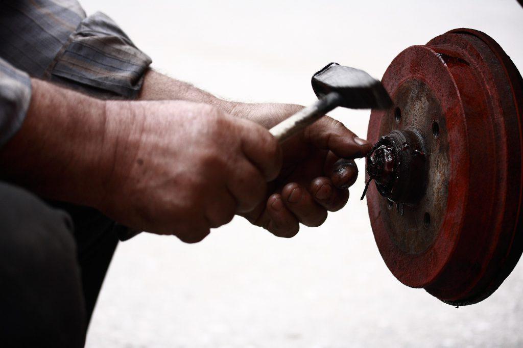 Man repairing a brake disc